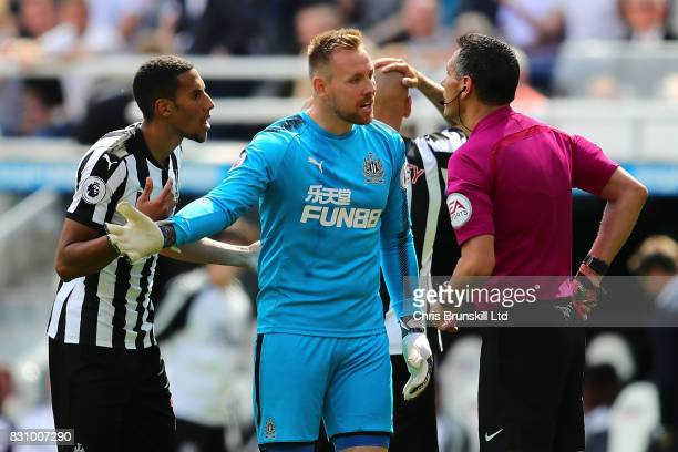 Robert Elliot of Newcastle United protest to Referee Andre Marriner after Jonjo Shelvey is sent off during the Premier League match between Newcastle...