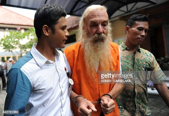 Robert Ellis of Australia is escorted by prosecutors to the court room before his trial in Denpasar on the Indonesian resort island of Bali on June...