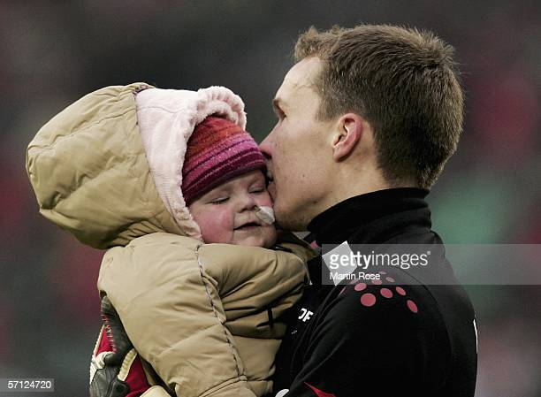 Robert Enke the goalkeeper of Hannover holds his daughter Lara after the Bundesliga match between Hanover 96 and 1FC Cologne at the AWD Arena on...