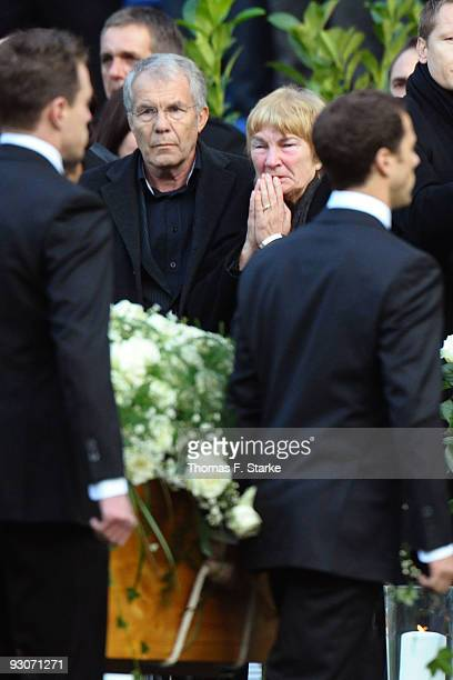 Robert Enkes parents Dirk and Gisela Enke look on while their sons coffin passes during the memorial service prior to Robert Enke's funeral at AWD...