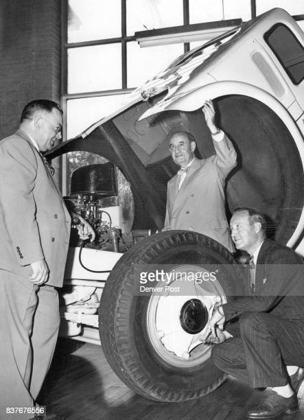 Robert F Black of Cleveland president of the White Motor company and Lon A Fleener of Kansas City regional manager look over a new White Truck with...