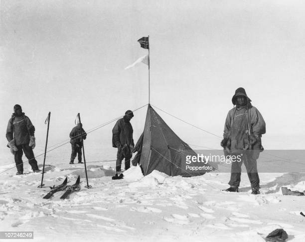 Robert Falcon Scott's party pose by the tent of Norwegian explorer Roald Amundsen at the South Pole during the Terra Nova Expedition 18th January...