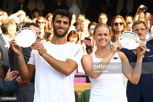 Robert Farah of Columbia and AnnaLena Groenefeld of Germany lift their trophies following defeat in the Mixed Doubles Final against Heather Watson of...
