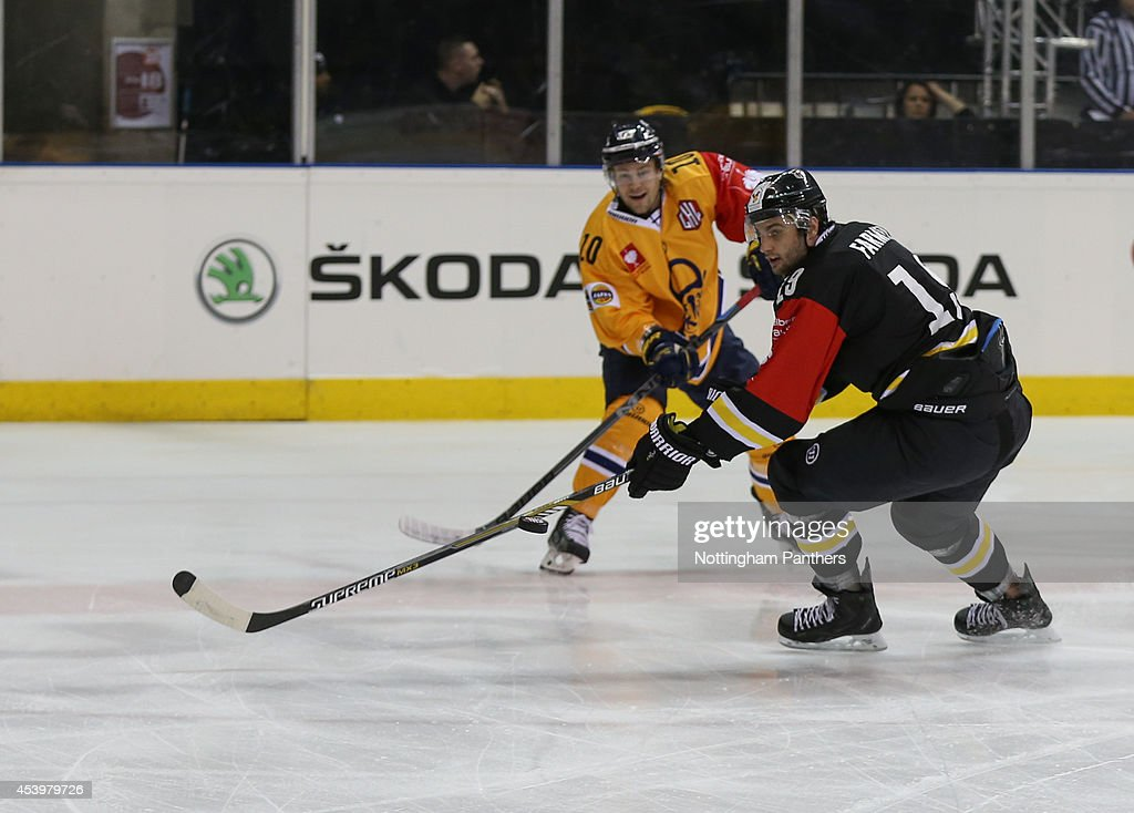 Robert Farmer #19 of Nottingham catches the puck, closely watched by Mikko Cousa #10 of Lukko Rauma during the Champions Hockey League group stage game at the National Ice Centre in Nottingham, between Nottingham Panthers and Lukko Rauma on August 22, 2014 in Nottingham, United Kingdom.