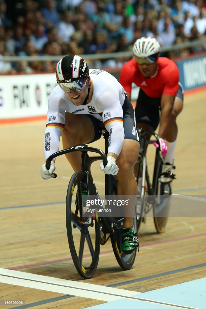 Robert Forstemann of Germany beats Njisane Nicholas Phillip of Trinidad and Tobago during the Men's Sprint Final on day three of the UCI Track Cycling World Cup at Manchester Velodrome on November 3, 2013 in Manchester, England.