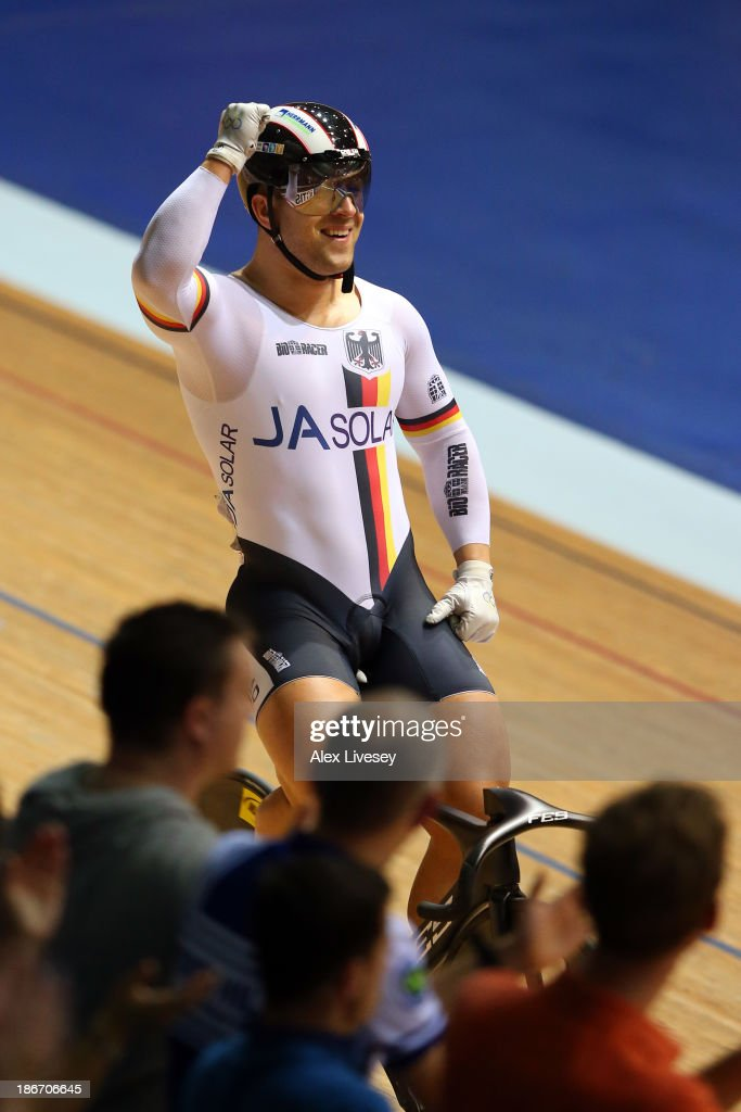 Robert Forstemann of Germany celebrates beating Njisane Nicholas Phillip of Trinidad and Tobago in the Men's Sprint Final on day three of the UCI Track Cycling World Cup at Manchester Velodrome on November 3, 2013 in Manchester, England.