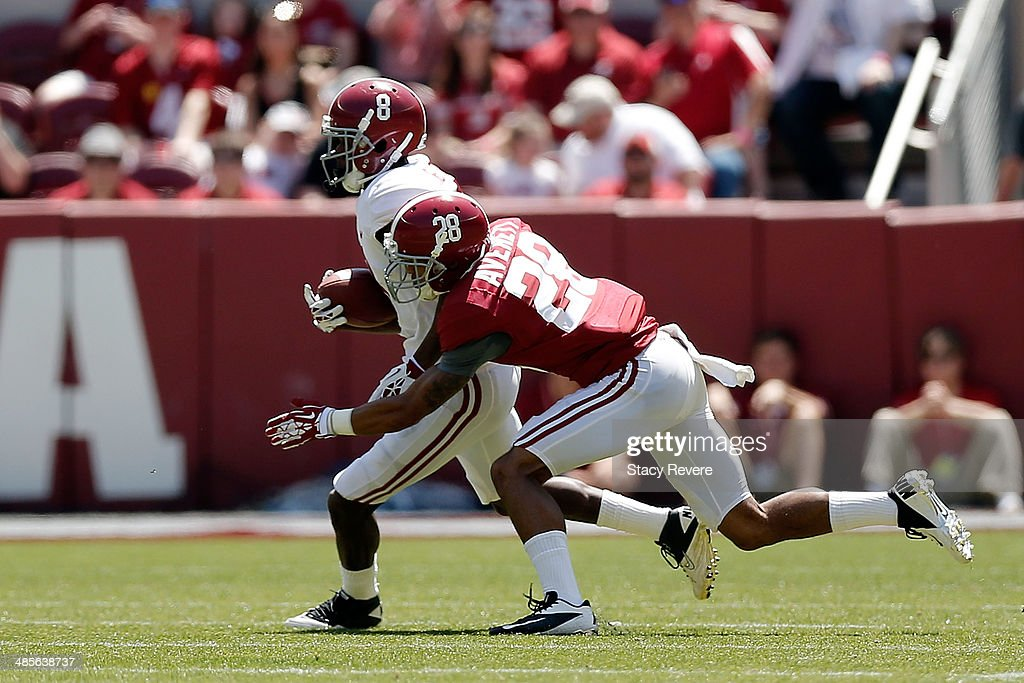 Robert Foster #8 of the White team catches a pass in front of Anthony Averett #28 of the Crimson team during the University of Alabama A-Day spring game at Bryant-Denny Stadium on April 19, 2014 in Tuscaloosa, Alabama.