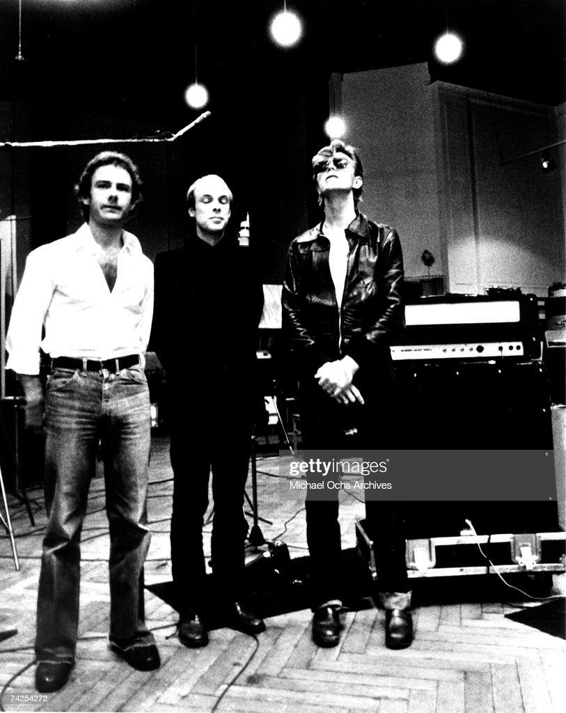 Robert Fripp, Brian Eno and David Bowie pose for a portrait in the studio where they are recorded 'Heroes' in 1977 in Berlin, Germany. Photo by Michael Ochs Archives/Getty Images