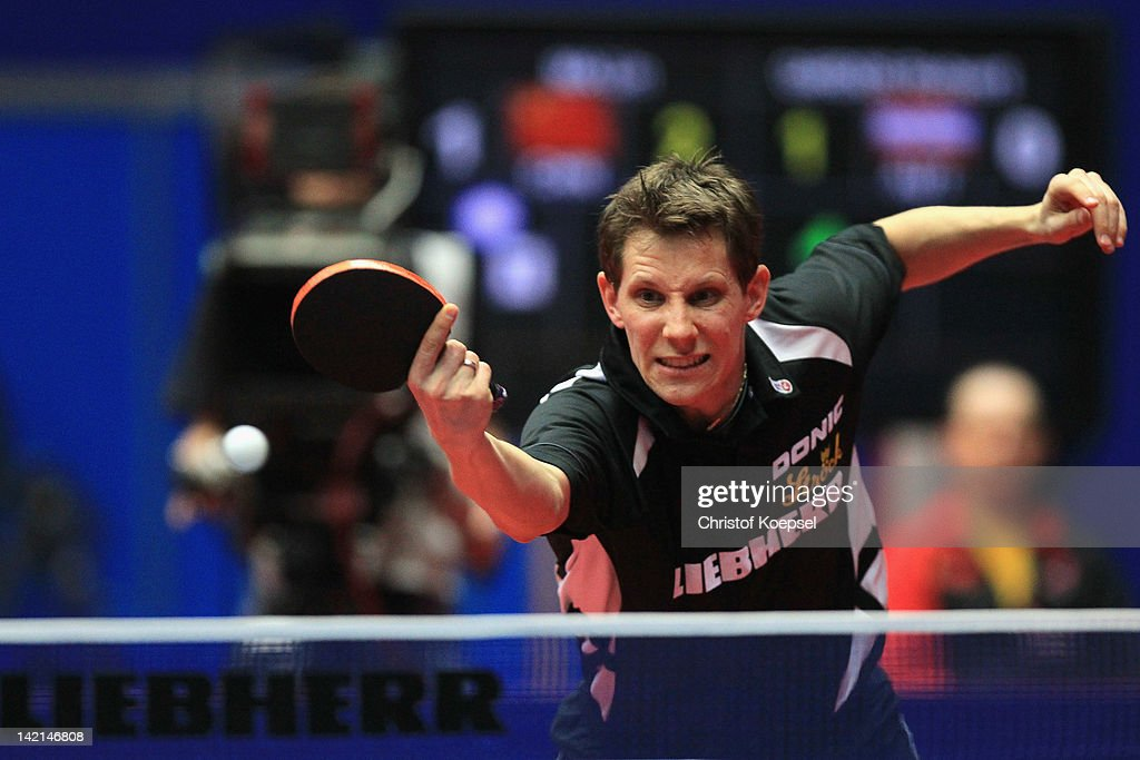 <a gi-track='captionPersonalityLinkClicked' href=/galleries/search?phrase=Robert+Gardos&family=editorial&specificpeople=2160529 ng-click='$event.stopPropagation()'>Robert Gardos</a> of Austria plays a backhand during his match against Ma Lin of China during the LIEBHERR table tennis team world cup 2012 championship division men's quarter final match between China and Austria at Westfalenhalle Dortmund on March 30, 2012 in Dortmund, Germany. China won 3-0 against Austria and plays on Saturday in the semi-final match.