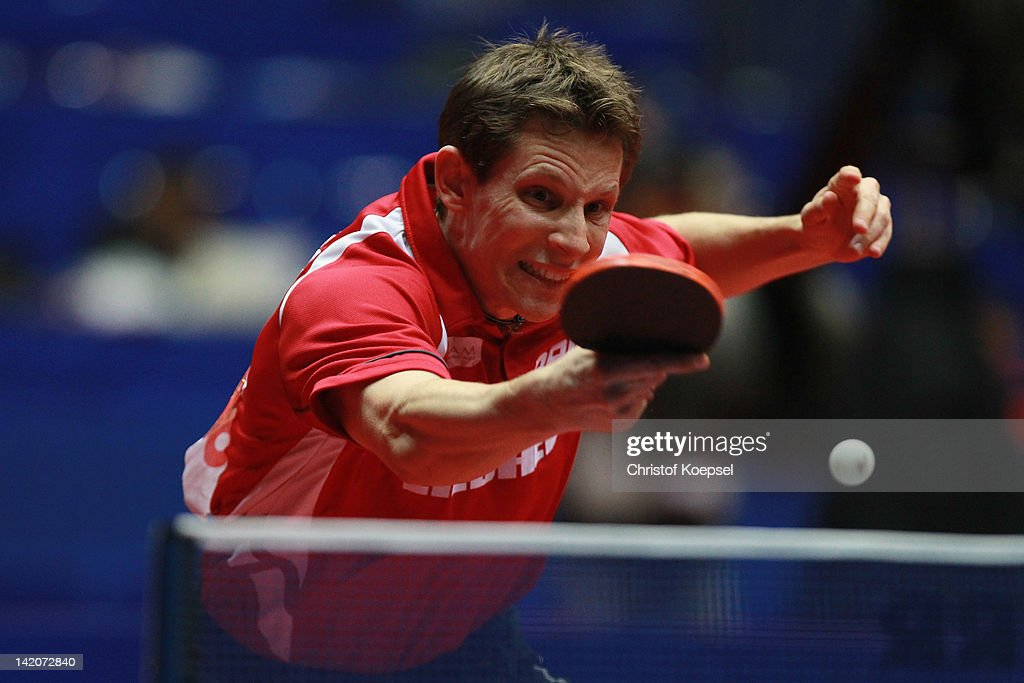 <a gi-track='captionPersonalityLinkClicked' href=/galleries/search?phrase=Robert+Gardos&family=editorial&specificpeople=2160529 ng-click='$event.stopPropagation()'>Robert Gardos</a> of Austria plays a backhand during his match against Bartosz Such of Poland during the LIEBHERR table tennis team world cup 2012 championship division round of last 16 men's team match between Poland and Austria at Westfalenhalle Dortmund on March 29, 2012 in Dortmund, Germany. Austria won 3-1 against Poland and plays int he quarter final match against China.
