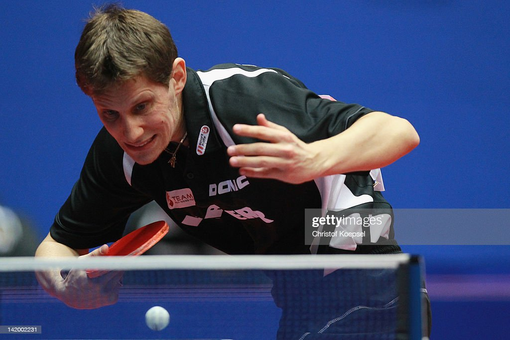 <a gi-track='captionPersonalityLinkClicked' href=/galleries/search?phrase=Robert+Gardos&family=editorial&specificpeople=2160529 ng-click='$event.stopPropagation()'>Robert Gardos</a> of Austria serves during his match against Joo Se Hyuk of South Korea during the LIEBHERR table tennis team world cup 2012 championship division group C men's team match between South Korea and Austria at Westfalenhalle Dortmund on March 28, 2012 in Dortmund, Germany. South Korea won 3-1 against Austria.