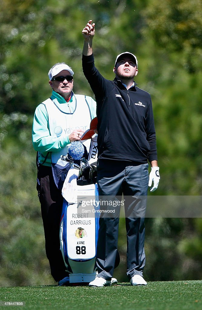 <a gi-track='captionPersonalityLinkClicked' href=/galleries/search?phrase=Robert+Garrigus&family=editorial&specificpeople=3232930 ng-click='$event.stopPropagation()'>Robert Garrigus</a> assesses the wind on the 7th hole during the first round of the Valspar Championship at Innisbrook Resort and Golf Club on March 13, 2014 in Palm Harbor, Florida.