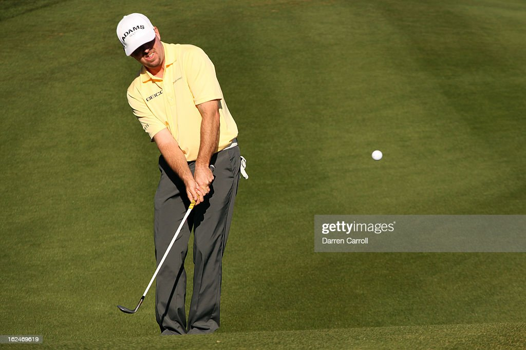 Robert Garrigus hits a chip shot on the 16th hole during the quarterfinal round of the World Golf Championships - Accenture Match Play at the Golf Club at Dove Mountain on February 23, 2013 in Marana, Arizona.