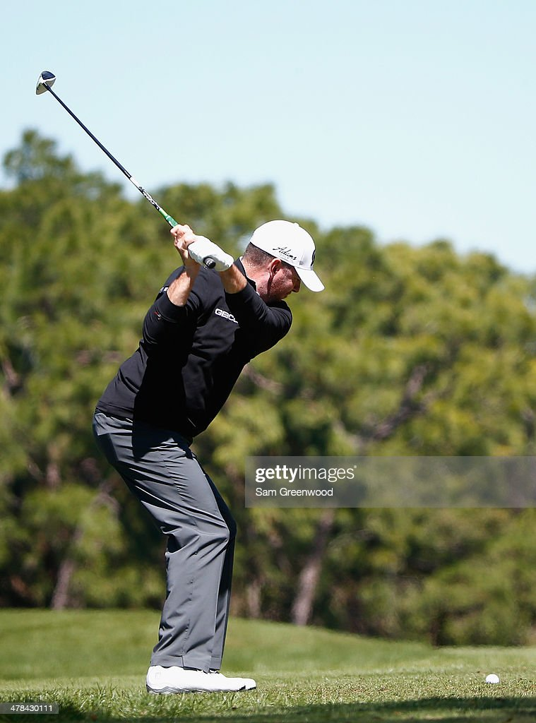 <a gi-track='captionPersonalityLinkClicked' href=/galleries/search?phrase=Robert+Garrigus&family=editorial&specificpeople=3232930 ng-click='$event.stopPropagation()'>Robert Garrigus</a> hits a tee shot on the 6th hole during the first round of the Valspar Championship at Innisbrook Resort and Golf Club on March 13, 2014 in Palm Harbor, Florida.