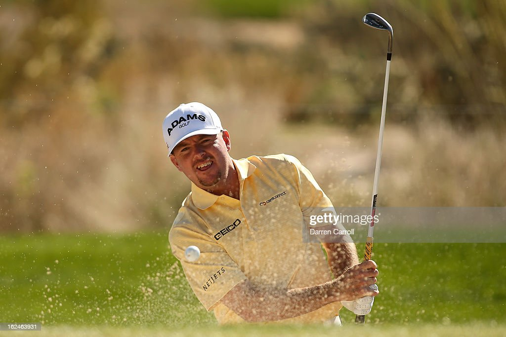 <a gi-track='captionPersonalityLinkClicked' href=/galleries/search?phrase=Robert+Garrigus&family=editorial&specificpeople=3232930 ng-click='$event.stopPropagation()'>Robert Garrigus</a> hits his fifth shot on the 11th hole during the quarterfinal round of the World Golf Championships - Accenture Match Play at the Golf Club at Dove Mountain on February 23, 2013 in Marana, Arizona.