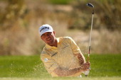 Robert Garrigus hits his fifth shot on the 11th hole during the quarterfinal round of the World Golf Championships Accenture Match Play at the Golf...