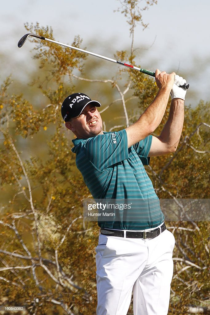 <a gi-track='captionPersonalityLinkClicked' href=/galleries/search?phrase=Robert+Garrigus&family=editorial&specificpeople=3232930 ng-click='$event.stopPropagation()'>Robert Garrigus</a> watches his second shot on the second hole during the third round of the Waste Management Phoenix Open at TPC Scottsdale on February 2, 2013 in Scottsdale, Arizona.