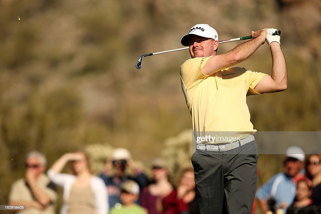 Robert Garrigus watches his tee shot on the 16th hole during the quarterfinal round of the World Golf Championships - Accenture Match Play at the Golf Club at Dove Mountain on February 23, 2013 in Marana, Arizona.