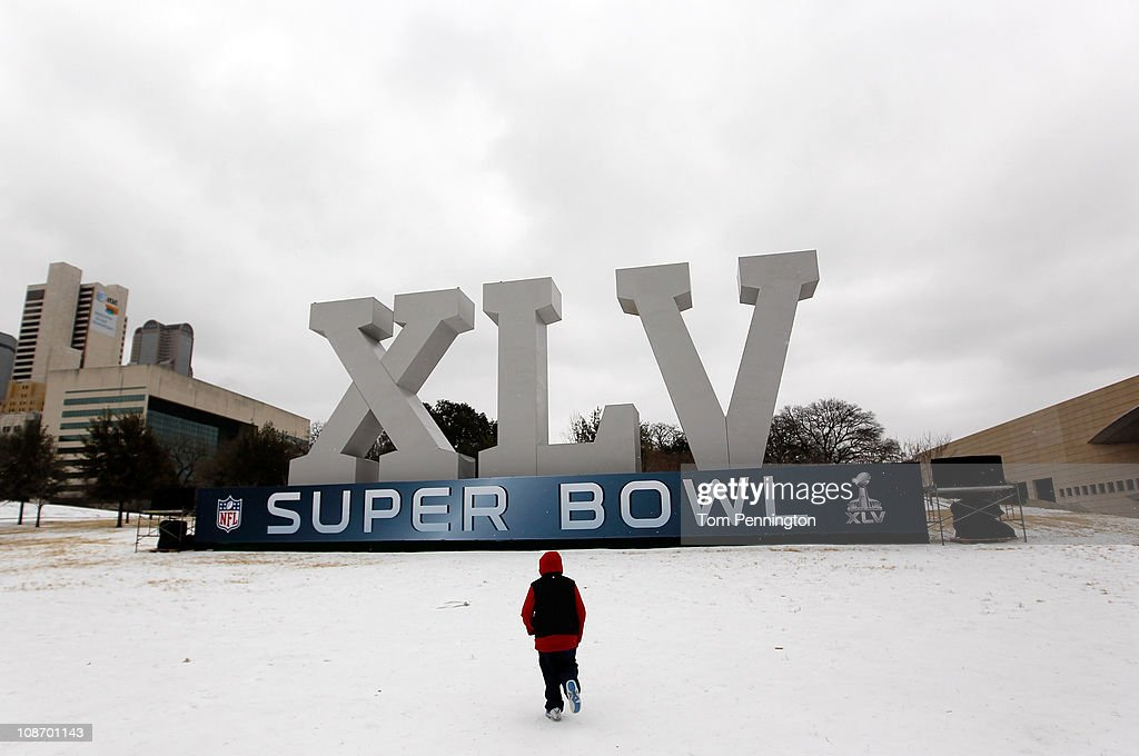 Robert Garza, 10, walks through snow and ice while visiting an NFL Super Bowl XLV display February 1, 2011 in Dallas, Texas. A major ice storm hit the Dallas/Fort Worth area overnight days before Super Bowl XLV is to be held in Arlington, Texas.