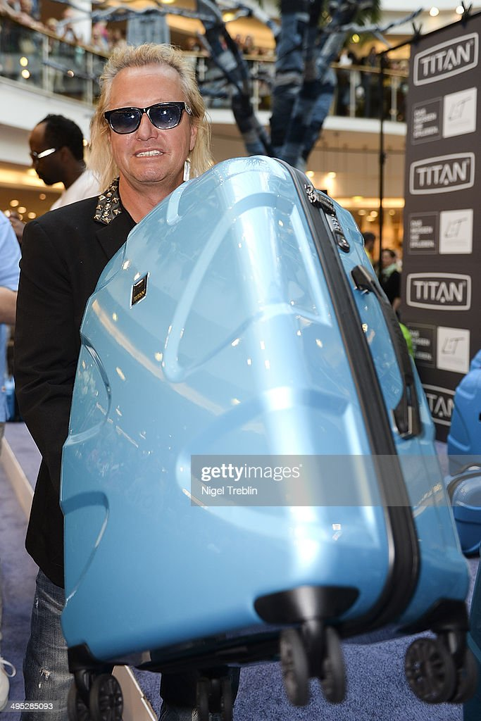 <a gi-track='captionPersonalityLinkClicked' href=/galleries/search?phrase=Robert+Geiss&family=editorial&specificpeople=6704195 ng-click='$event.stopPropagation()'>Robert Geiss</a> poses with a Titan suitcase during the opening event of a new Titan Shop on June 2, 2014 in Osnabruck, Germany.