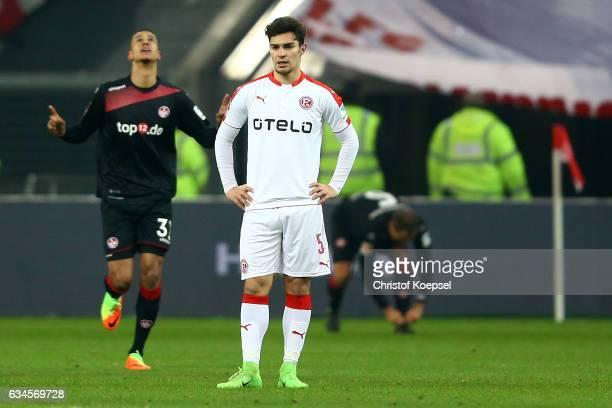 Robert Glatzel ka0 celebrates the first goal and Kaan Ayhan of Duesseldorf looks dejected during the Second Bundesliga match between Fortuna...
