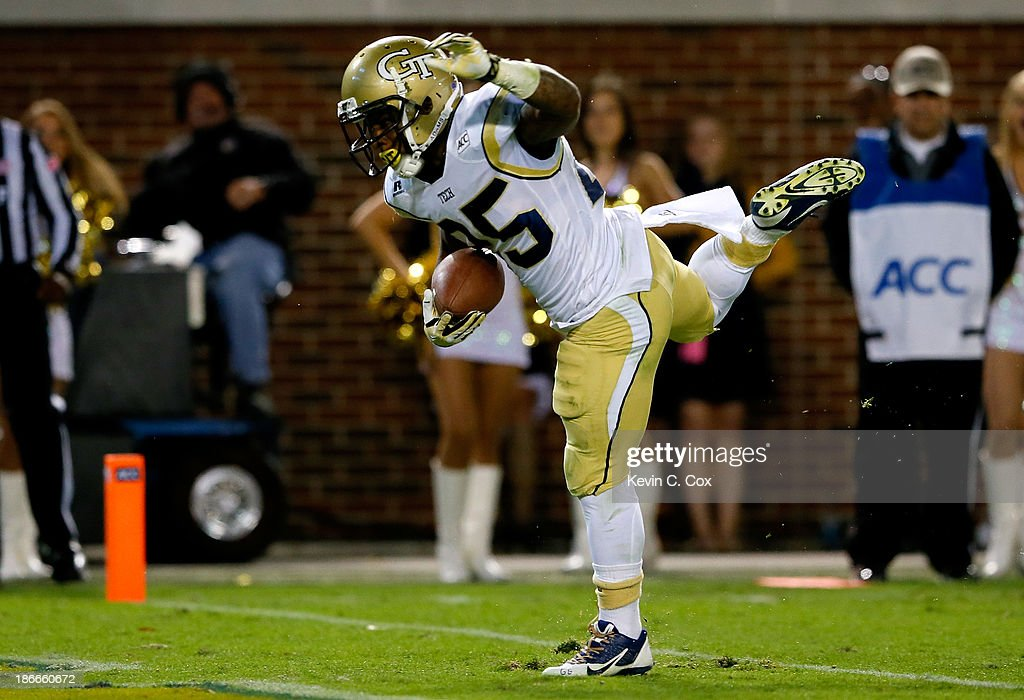 Robert Godhigh #25 of the Georgia Tech Yellow Jackets scores a touchdown against the Pittsburgh Panthers at Bobby Dodd Stadium on November 2, 2013 in Atlanta, Georgia.