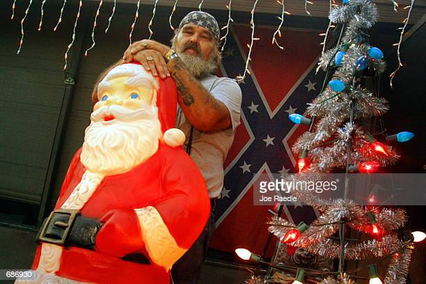 Robert Godwin who said he could be called a 'redneck Santa' poses with his decorations December 11 2001 in Christmas FL This community of about 3000...