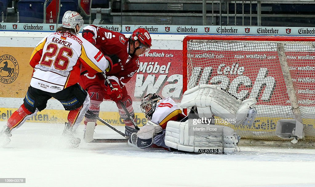 Robert Goepfert goaltender of Duesseldorf makes a save on David Sulkovsky of Hannover during the DEL match between Hannover Scorpions and DEG Metro...