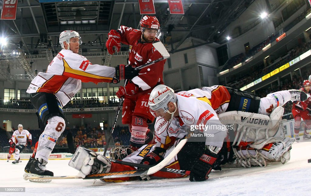 Robert Goepfert goaltender of Duesseldorf makes a save on Gerrit Fauser during the DEL match between Hannover Scorpions and DEG Metro Stars at TUI...