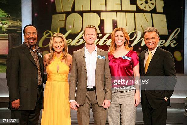 Robert Gossett cohost Vanna White Neil Patrick Harris Diane Neal and host Pat Sajak pose for photos during a taping of 'Wheel Of Fortune Celebrity...