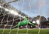Robert Green of Queens Park Rangers fails to save a goal by Eden Hazard of Chelsea during the Barclays Premier League match between Chelsea and...