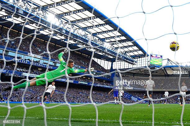 Robert Green of Queens Park Rangers fails to save a goal by Oscar of Chelsea during the Barclays Premier League match between Chelsea and Queens Park...