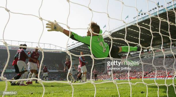 Robert Green of West Ham United dives to try to save the header of Phil Jagielka of Sheffield United who scored his team's second goal during the...