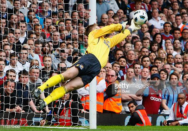 Robert Green of West Ham United makes a diving save during the Barclays Premier League match between West Ham United and Aston Villa at the Boleyn...