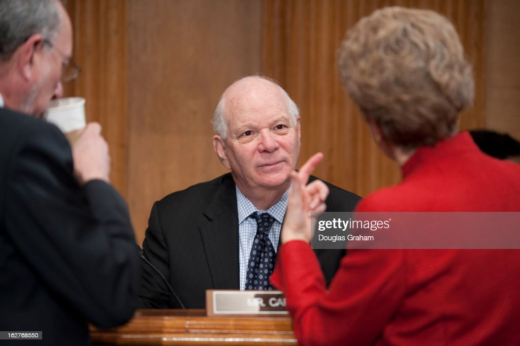 Robert Greenstein the founder and President of the Center on Budget and Policy Priorities, Sen. Ben Cardin, D-MD., talks with staff before the start of the Senate Finance Committee markup of the nominations of Jacob 'Jack' Lew to be Treasury secretary, William Schultz to be Health and Human Services general counsel, and Christopher Meade to be Treasury general counsel followed by an organization vote including subcommittee assignments on February 26, 2013.