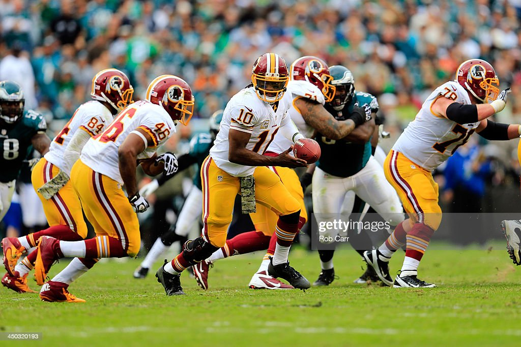 <a gi-track='captionPersonalityLinkClicked' href=/galleries/search?phrase=Robert+Griffin&family=editorial&specificpeople=2495030 ng-click='$event.stopPropagation()'>Robert Griffin</a> III #10 hands the ball off to running back <a gi-track='captionPersonalityLinkClicked' href=/galleries/search?phrase=Alfred+Morris&family=editorial&specificpeople=6350964 ng-click='$event.stopPropagation()'>Alfred Morris</a> #46 of the Washington Redskins against the Philadelphia Eagles at Lincoln Financial Field on November 17, 2013 in Philadelphia, Pennsylvania.