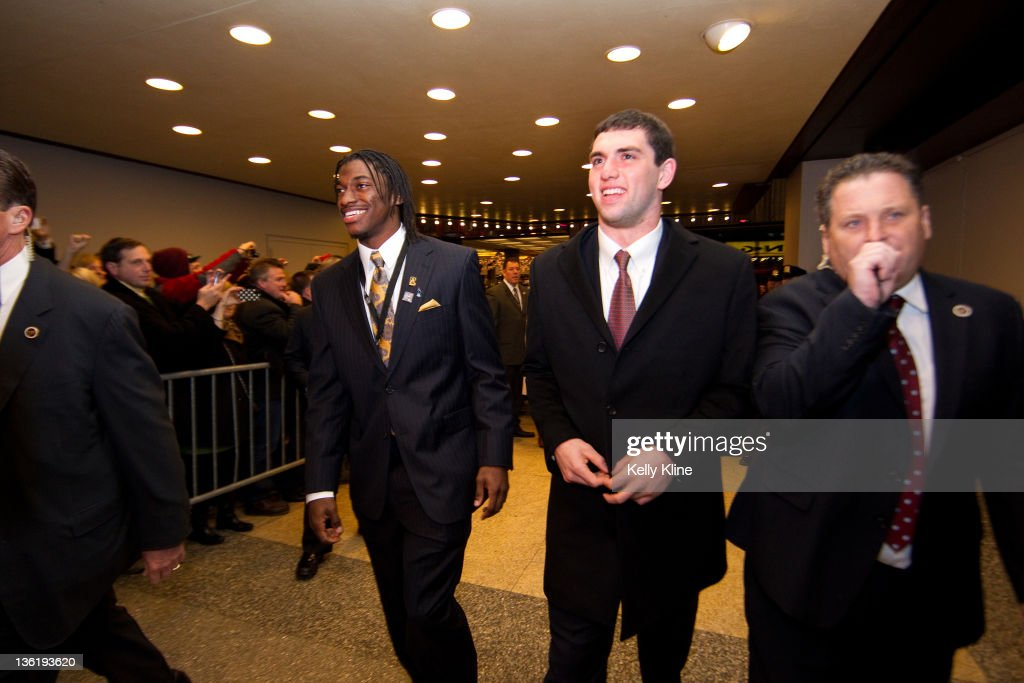 Robert Griffin III of the Baylor Bears and Andrew Luck of the Stanford Cardinal arrive to a sea of fans at the Best Buy Theater prior to the 77th Heisman Trophy Presentation on December 10, 2011 in New York City.