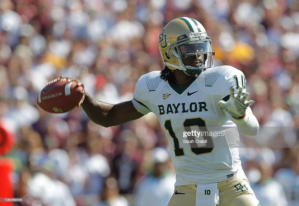 <a gi-track='captionPersonalityLinkClicked' href=/galleries/search?phrase=Robert+Griffin&family=editorial&specificpeople=2495030 ng-click='$event.stopPropagation()'>Robert Griffin</a> III #10 of the Baylor Bears passes during a game against the Texas A&M Aggies at Kyle Field on October 15, 2011 in College Station, Texas.