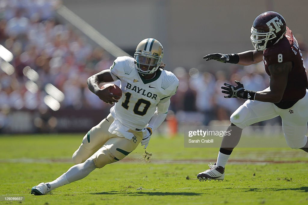 <a gi-track='captionPersonalityLinkClicked' href=/galleries/search?phrase=Robert+Griffin&family=editorial&specificpeople=2495030 ng-click='$event.stopPropagation()'>Robert Griffin</a> III #10 of the Baylor Bears runs during a game against the Texas A&M Aggies at Kyle Field on October 15, 2011 in College Station, Texas.