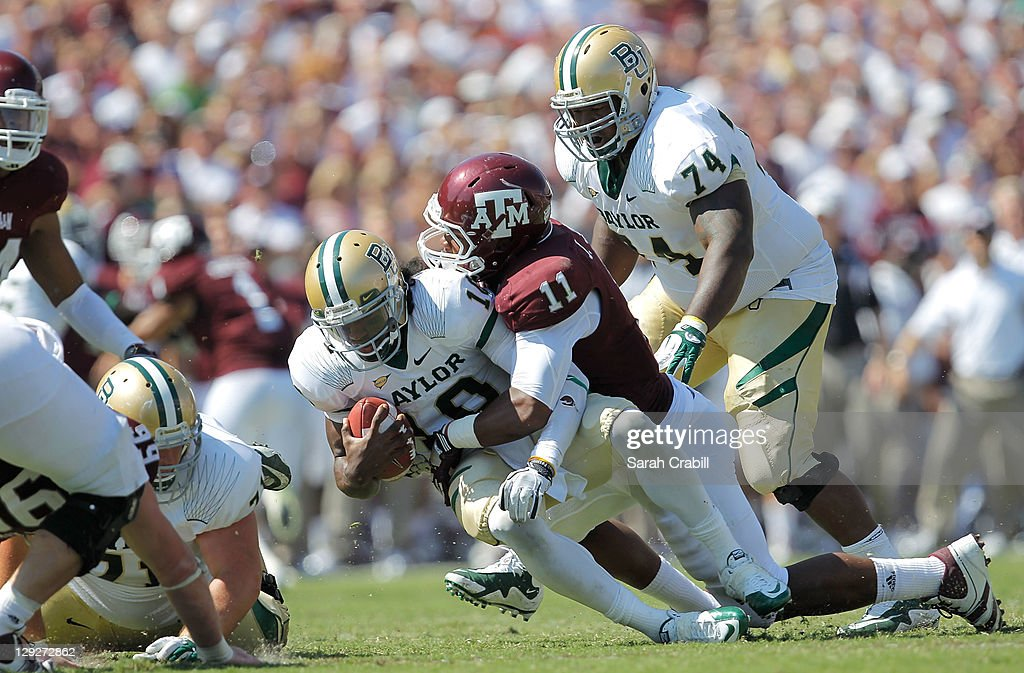 <a gi-track='captionPersonalityLinkClicked' href=/galleries/search?phrase=Robert+Griffin&family=editorial&specificpeople=2495030 ng-click='$event.stopPropagation()'>Robert Griffin</a> III #10 of the Baylor Bears takes a sack during a game against the Texas A&M Aggies at Kyle Field on October 15, 2011 in College Station, Texas. The Texas A&M Aggies defeated the Baylor Bears 55-28.