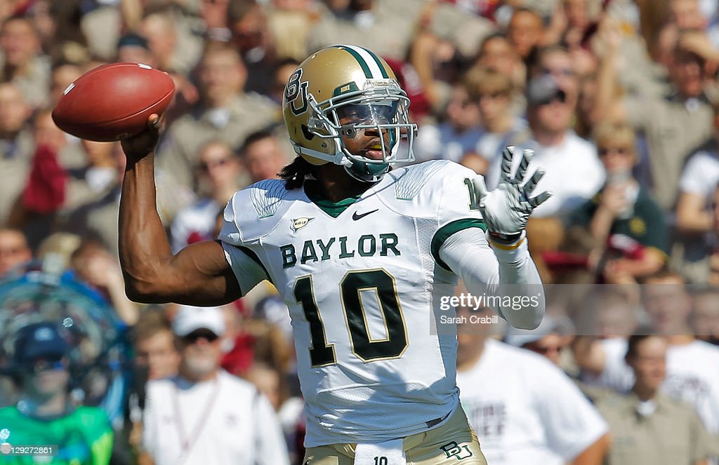 <a gi-track='captionPersonalityLinkClicked' href=/galleries/search?phrase=Robert+Griffin&family=editorial&specificpeople=2495030 ng-click='$event.stopPropagation()'>Robert Griffin</a> III #10 of the Baylor Bears throws during a game against the Texas A&M Aggies at Kyle Field on October 15, 2011 in College Station, Texas. The Texas A&M Aggies defeated the Baylor Bears 55-28.