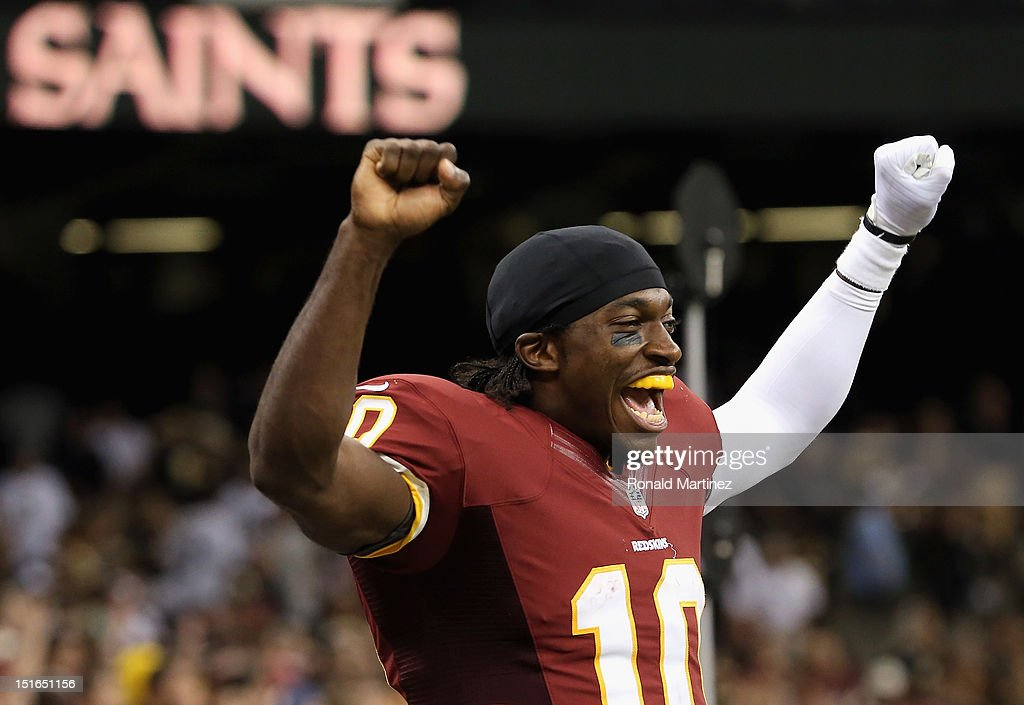 <a gi-track='captionPersonalityLinkClicked' href=/galleries/search?phrase=Robert+Griffin&family=editorial&specificpeople=2495030 ng-click='$event.stopPropagation()'>Robert Griffin</a> III #10 of the Washington Redskins celebrates a 40-32 win against the New Orleans Saints during the season opener at Mercedes-Benz Superdome on September 9, 2012 in New Orleans, Louisiana.