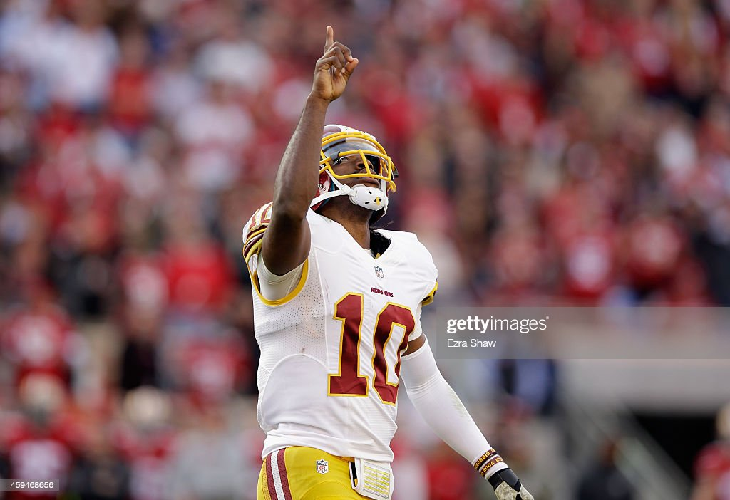 <a gi-track='captionPersonalityLinkClicked' href=/galleries/search?phrase=Robert+Griffin&family=editorial&specificpeople=2495030 ng-click='$event.stopPropagation()'>Robert Griffin</a> III #10 of the Washington Redskins celebrates after a touchdown in the first half against the San Francisco 49ers at Levi's Stadium on November 23, 2014 in Santa Clara, California.