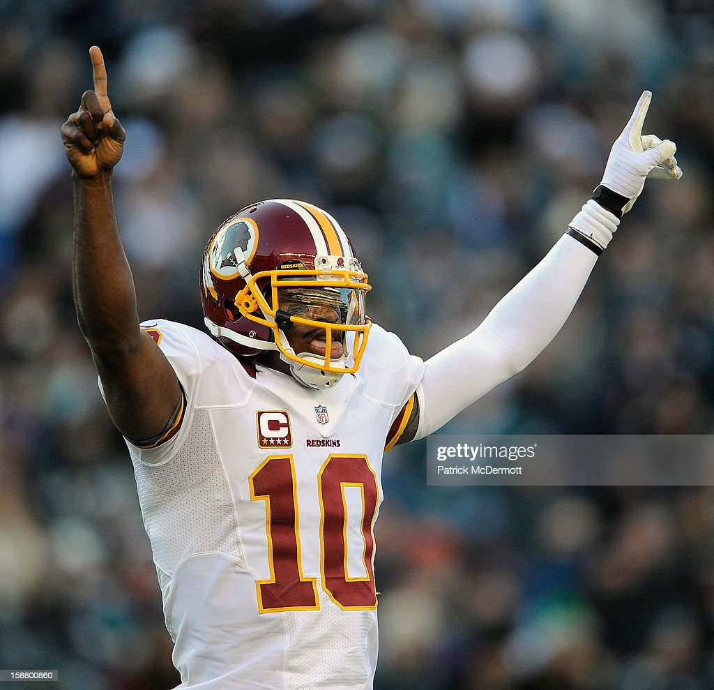 <a gi-track='captionPersonalityLinkClicked' href=/galleries/search?phrase=Robert+Griffin&family=editorial&specificpeople=2495030 ng-click='$event.stopPropagation()'>Robert Griffin</a> III #10 of the Washington Redskins celebrates after a Washington Redskins first down in the fourth quarter against the Philadelphia Eagles at Lincoln Financial Field on December 23, 2012 in Philadelphia, Pennsylvania.