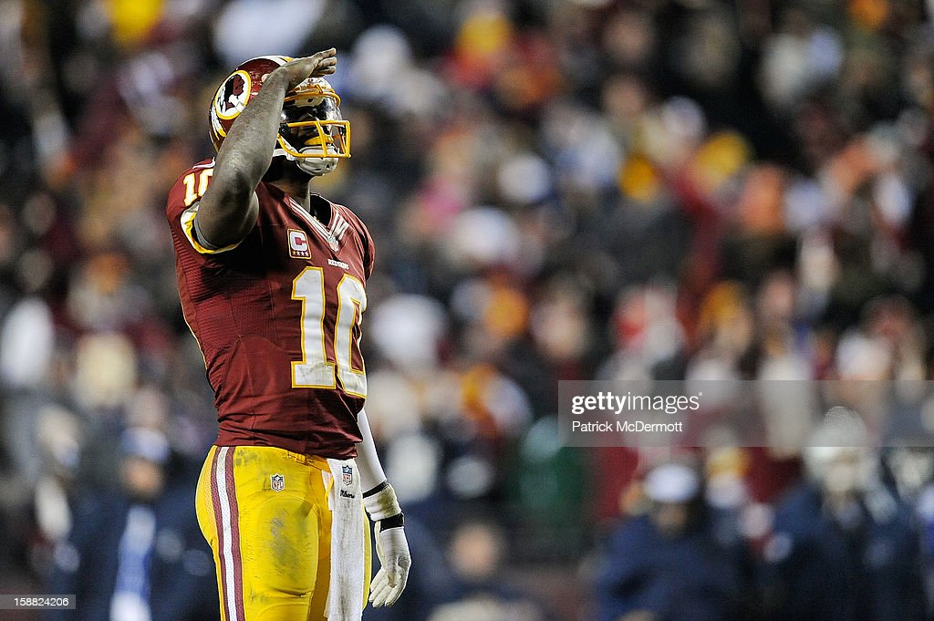 <a gi-track='captionPersonalityLinkClicked' href=/galleries/search?phrase=Robert+Griffin&family=editorial&specificpeople=2495030 ng-click='$event.stopPropagation()'>Robert Griffin</a> III #10 of the Washington Redskins celebrates after Alfred Morris #46 scored a touchdown in the fourth quarter against the Dallas Cowboys at FedExField on December 30, 2012 in Landover, Maryland. The Washington Redskins defeated the Dallas Cowboys 28-18.