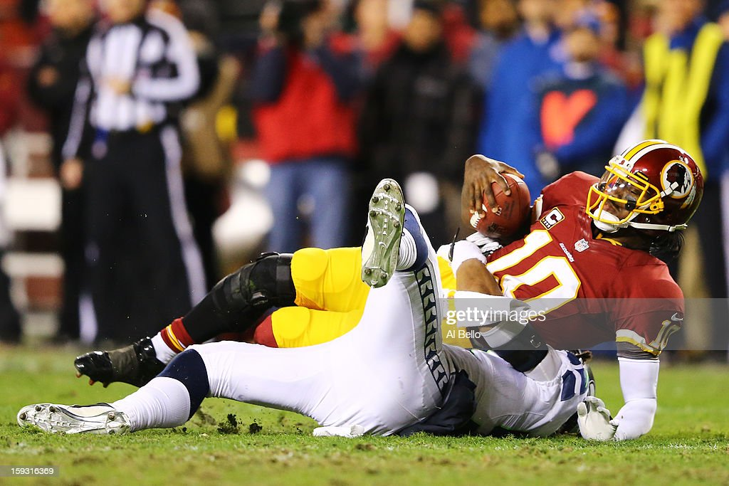 Robert Griffin III #10 of the Washington Redskins is sacked during the NFC Wild Card Playoff Game against the Seattle Seahawks at FedExField on January 6, 2013 in Landover, Maryland.