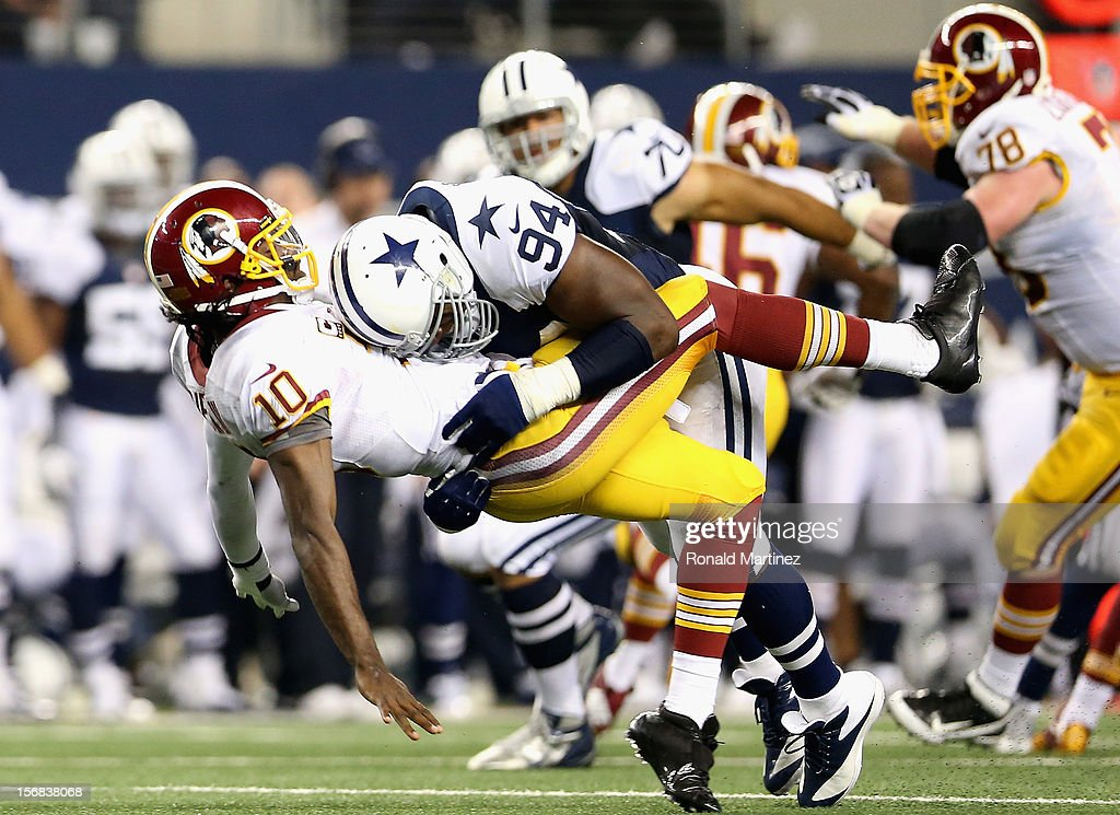 <a gi-track='captionPersonalityLinkClicked' href=/galleries/search?phrase=Robert+Griffin&family=editorial&specificpeople=2495030 ng-click='$event.stopPropagation()'>Robert Griffin</a> III #10 of the Washington Redskins is tackled by <a gi-track='captionPersonalityLinkClicked' href=/galleries/search?phrase=DeMarcus+Ware&family=editorial&specificpeople=756468 ng-click='$event.stopPropagation()'>DeMarcus Ware</a> #94 of the Dallas Cowboys during a Thanksgiving Day game at Cowboys Stadium on November 22, 2012 in Arlington, Texas.