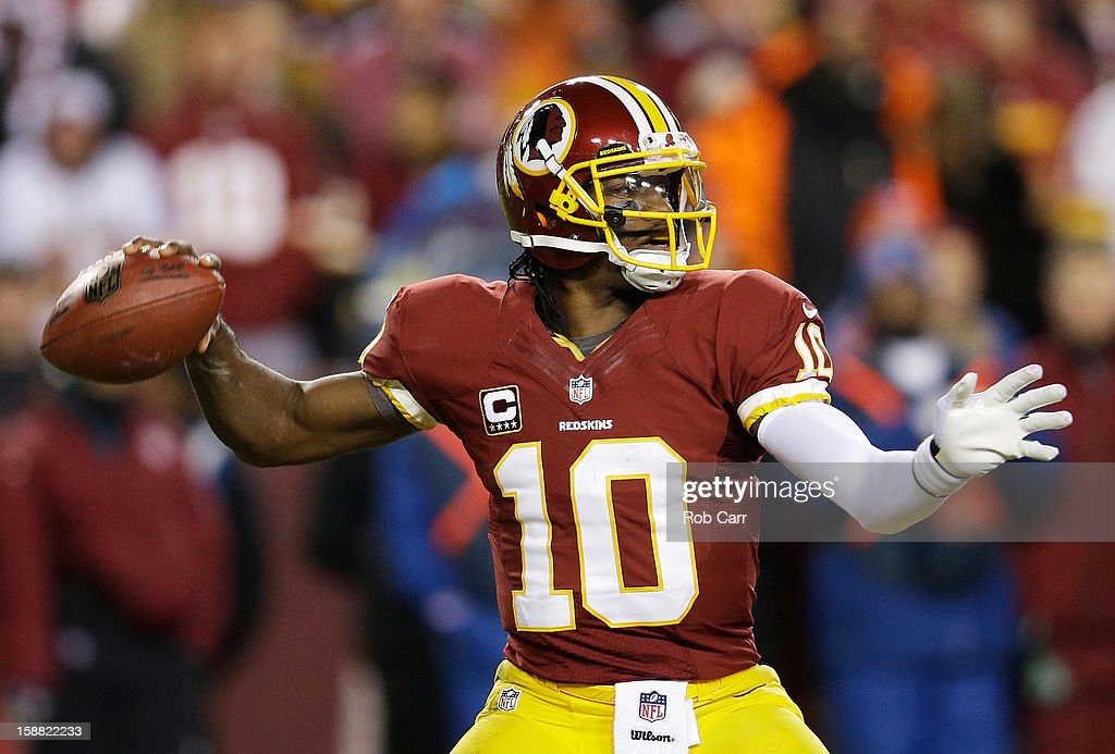 Robert Griffin III #10 of the Washington Redskins looks ot pass against the Dallas Cowboys in the second quarter at FedExField on December 30, 2012 in Landover, Maryland.