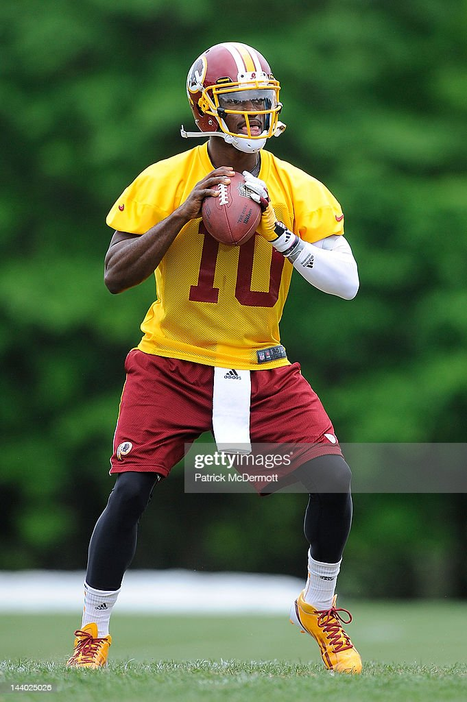 Robert Griffin III #10 of the Washington Redskins practices during the Washington Redskins rookie minicamp on May 6, 2012 in Ashburn, Virginia.