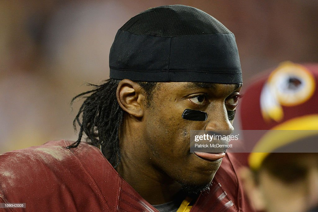 Robert Griffin III #10 of the Washington Redskins walks off of the field injured in the fourth quarter against the Seattle Seahawks during the NFC Wild Card Playoff Game at FedExField on January 6, 2013 in Landover, Maryland.